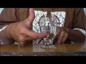 sulap - coin menembus gelas